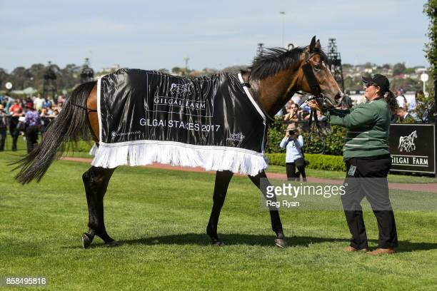 Keen Array with strapper Jess Carmichael after winning the Gilgai Stakes at Flemington Racecourse on October 07 2017 in Flemington Australia