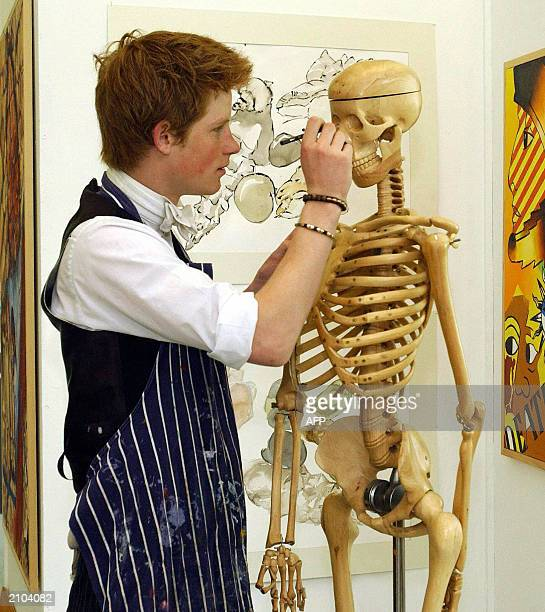 A keen artist Prince Harry the younger son of the Prince of Wales at work 12 May 2003 in Eton College's Drawing School which was opened last autumn...