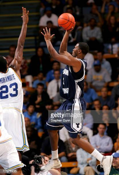 Keena Young of the BYU Cougars shoots over Luc Richard Mbah A Moute of the UCLA Bruins on November 15 2006 at Pauley Pavilion in Westwood California...