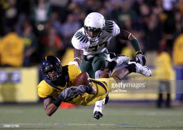 Keenan Allen of the California Golden Bears dives for the ball while defended by Talmadge Jackson III of the Oregon Ducks at California Memorial...
