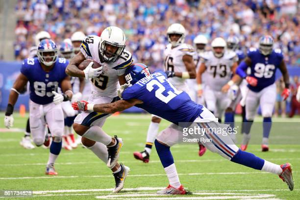 Keenan Allen of the Los Angeles Chargers attempts to break the tackle of Darian Thompson of the New York Giants during an NFL game at MetLife Stadium...