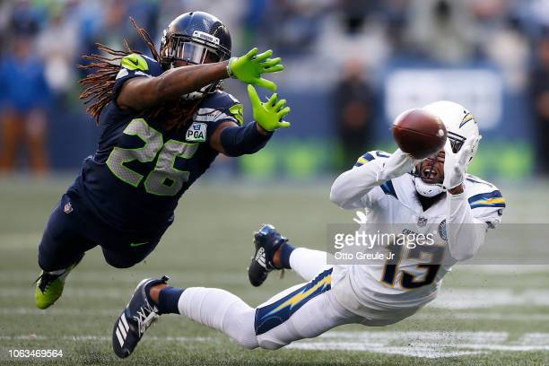 Keenan Allen of the Los Angeles Chargers attempts to make a catch while being guarded by Shaquill Griffin of the Seattle Seahawks in the second...