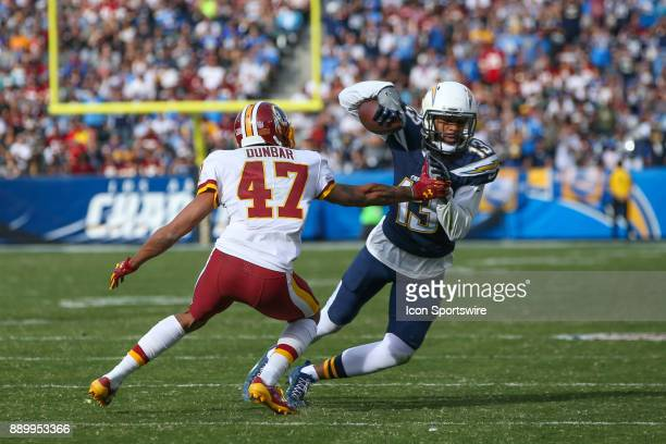 Keenan Allen of the Los Angeles Chargers being guarded by Quinton Dunbar of the Washington Redskins during a NFL game between the Washington Redskins...