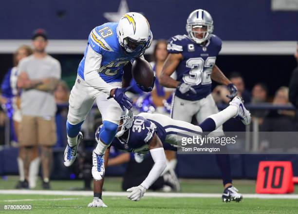 Keenan Allen of the Los Angeles Chargers breaks tackle by Anthony Brown of the Dallas Cowboys on a touchdown run in the fourth quarter at ATT Stadium...