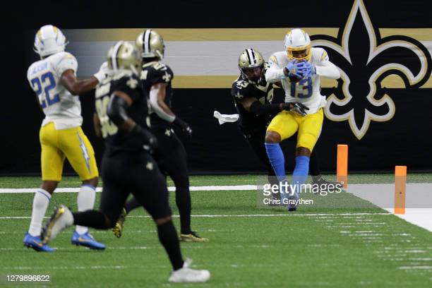 Keenan Allen of the Los Angeles Chargers catches a 17-yard touchdown against the New Orleans Saints in the first quarter of their NFL game at...