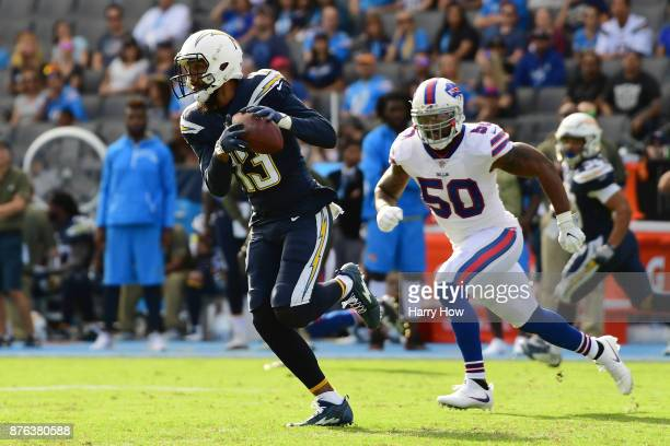 Keenan Allen of the Los Angeles Chargers catches the pass in front of Ramon Humber of the Buffalo Bills during the first half of the game at the...