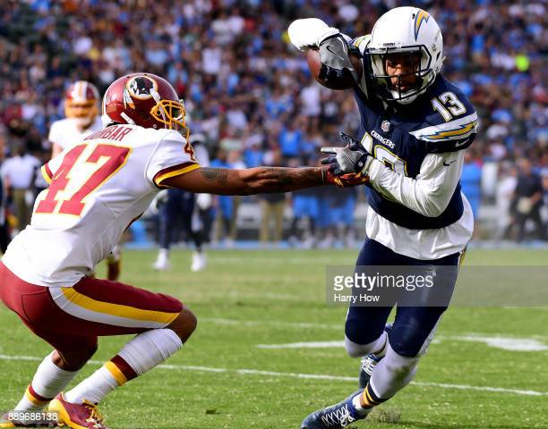 Keenan Allen of the Los Angeles Chargers cuts back away from Quinton Dunbar of the Washington Redskins after his catch for a first down during the...