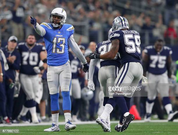 Keenan Allen of the Los Angeles Chargers gestures for a first down against the Dallas Cowboys in the first half of a football game at ATT Stadium on...