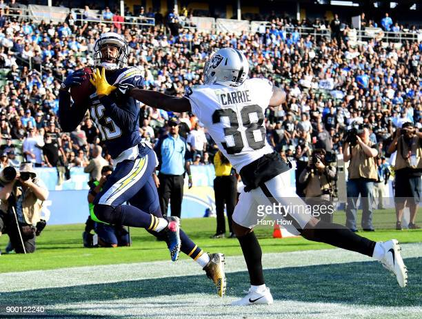 Keenan Allen of the Los Angeles Chargers makes a catch for a touchdown past TJ Carrie of the Oakland Raiders to take a 2010 lead during the first...
