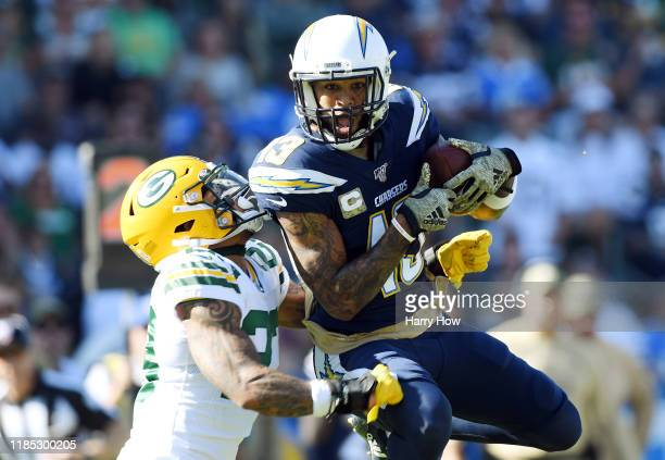 Keenan Allen of the Los Angeles Chargers makes a reception against Jaire Alexander of the Green Bay Packers during the first quarter at Dignity...