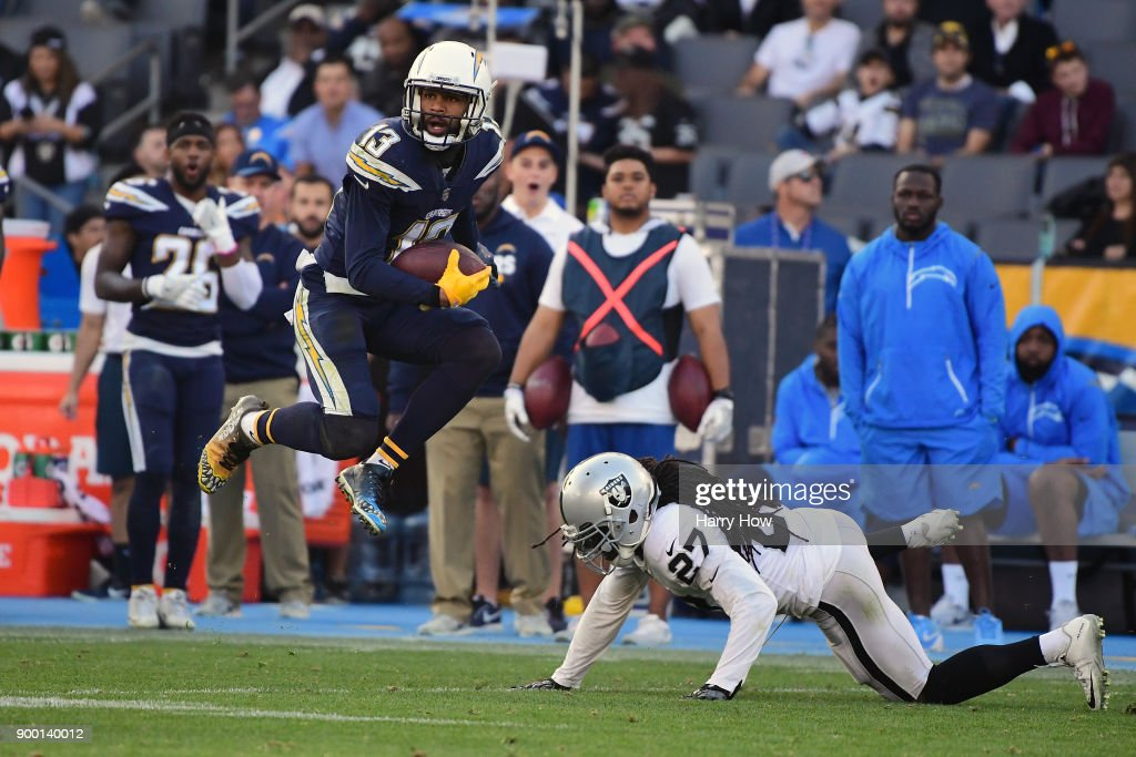 Keenan Allen #13 of the Los Angeles Chargers makes a reception against Reggie Nelson #27 of the Oakland Raiders during the second quarter of the game at StubHub Center on December 31, 2017 in Carson, California.