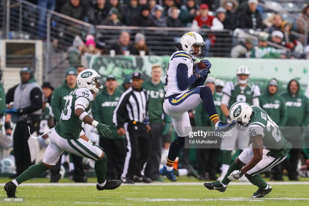 Keenan Allen #13 of the Los Angeles Chargers makes the catch under pressure from Jamal Adams #33 and Marcus Maye #26 of the New York Jets during the second half of an NFL game at MetLife Stadium on December 24, 2017 in East Rutherford, New Jersey. The Los Angeles Chargers defeated the New York Jets 14-7.