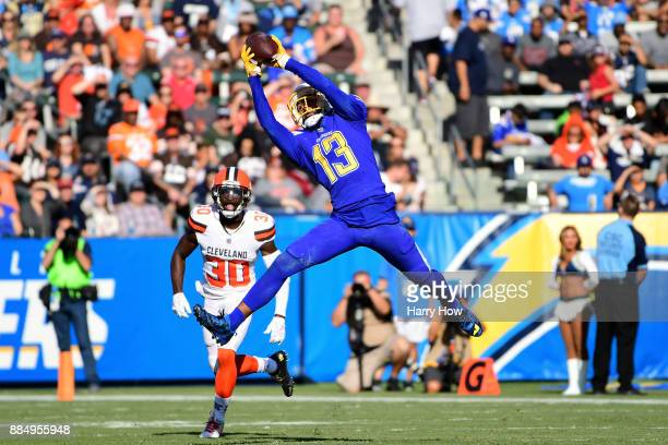 Keenan Allen of the Los Angeles Chargers matches the catch in front Jason McCourty of the Cleveland Browns for a first down during the second quarter...