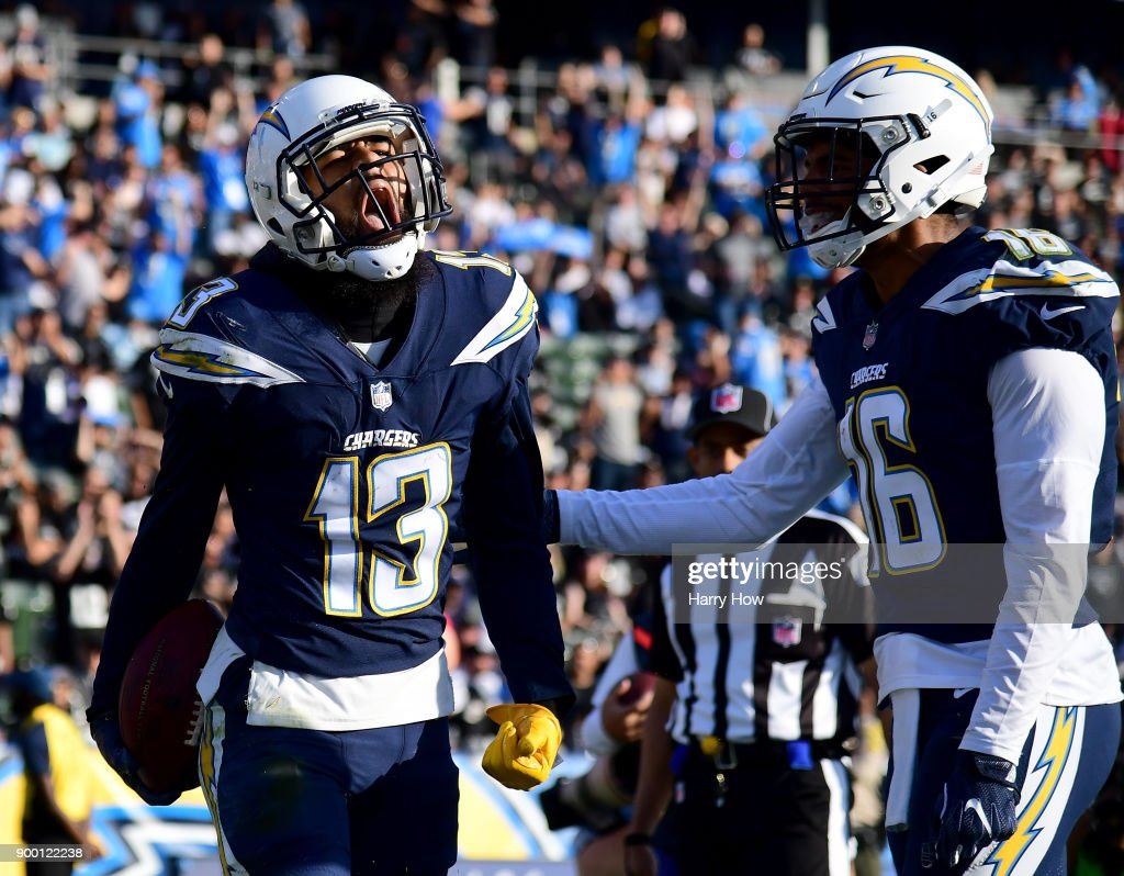 Keenan Allen #13 of the Los Angeles Chargers reacts to his touchdown catch in front of Tyrell Williams #16 to take a 20-10 lead over the Oakland Raiders during the first half at StubHub Center on December 31, 2017 in Carson, California.