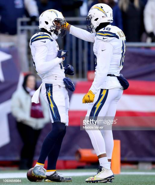 Keenan Allen of the Los Angeles Chargers reacts with Tyrell Williams after scoring a touchdown during the first quarter in the AFC Divisional Playoff...