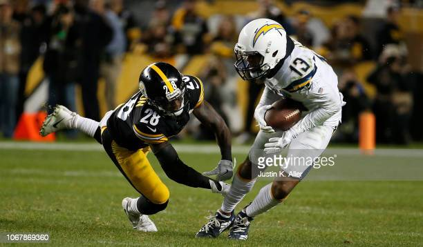Keenan Allen of the Los Angeles Chargers runs to avoid a tackle attempt by Mike Hilton of the Pittsburgh Steelers in the second quarter during the...