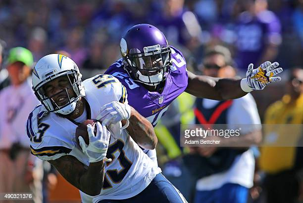 Keenan Allen of the San Diego Chargers pulls in a pass for a touchdown while Xavier Rhodes of the Minnesota Vikings applies pressure in the second...