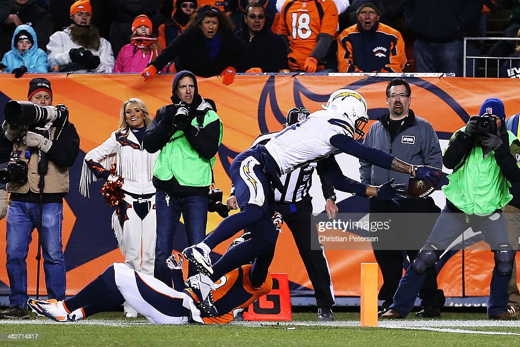 Keenan Allen #13 of the San Diego Chargers scores a fourth quarter touchdown against Michael Huff #29 of the Denver Broncos during the AFC Divisional Playoff Game at Sports Authority Field at Mile High on January 12, 2014 in Denver, Colorado.