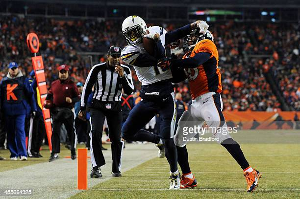 Keenan Allen of the San Diego Chargers scores a second quarter touchdown against Mike Adams of the Denver Broncos at Sports Authority Field at Mile...