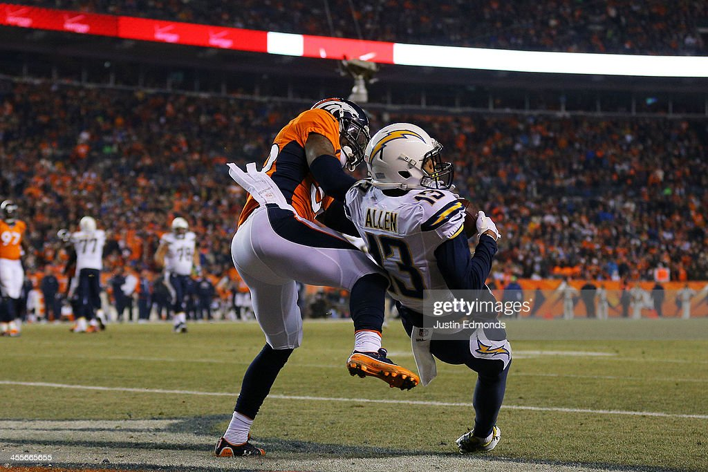 Keenan Allen #13 of the San Diego Chargers scores a second quarter touchdown against the defense of Kayvon Webster #36 of the Denver Broncos at Sports Authority Field at Mile High on December 12, 2013 in Denver, Colorado.