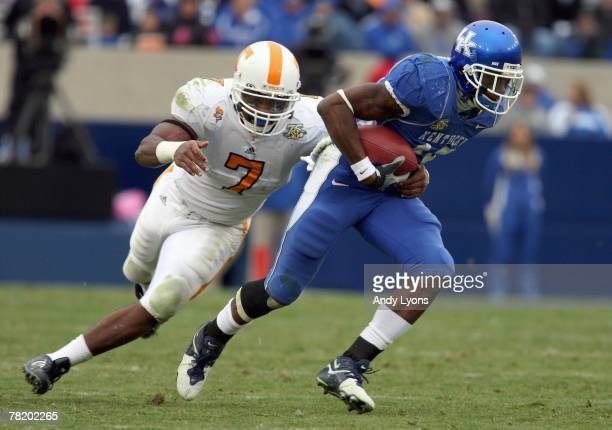 Keenan Burton of the Kentucky Wildcats carries the ball during the SEC game against Jerod Mayo of the Tennessee Volunteers at Commonwealth Stadium...