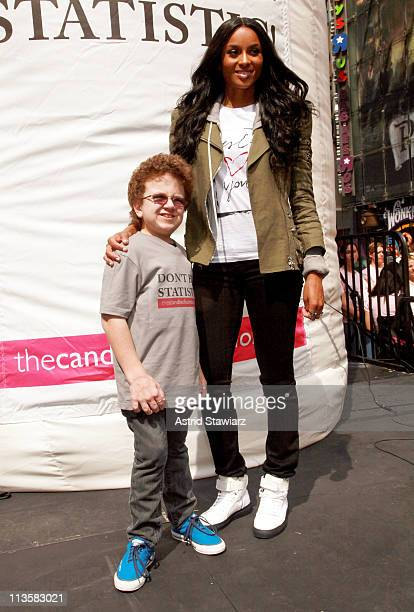 Keenan Cahill and Ciara perform in honor of National Teen Pregnancy Awareness Month in Times Square on May 3, 2011 in New York City.