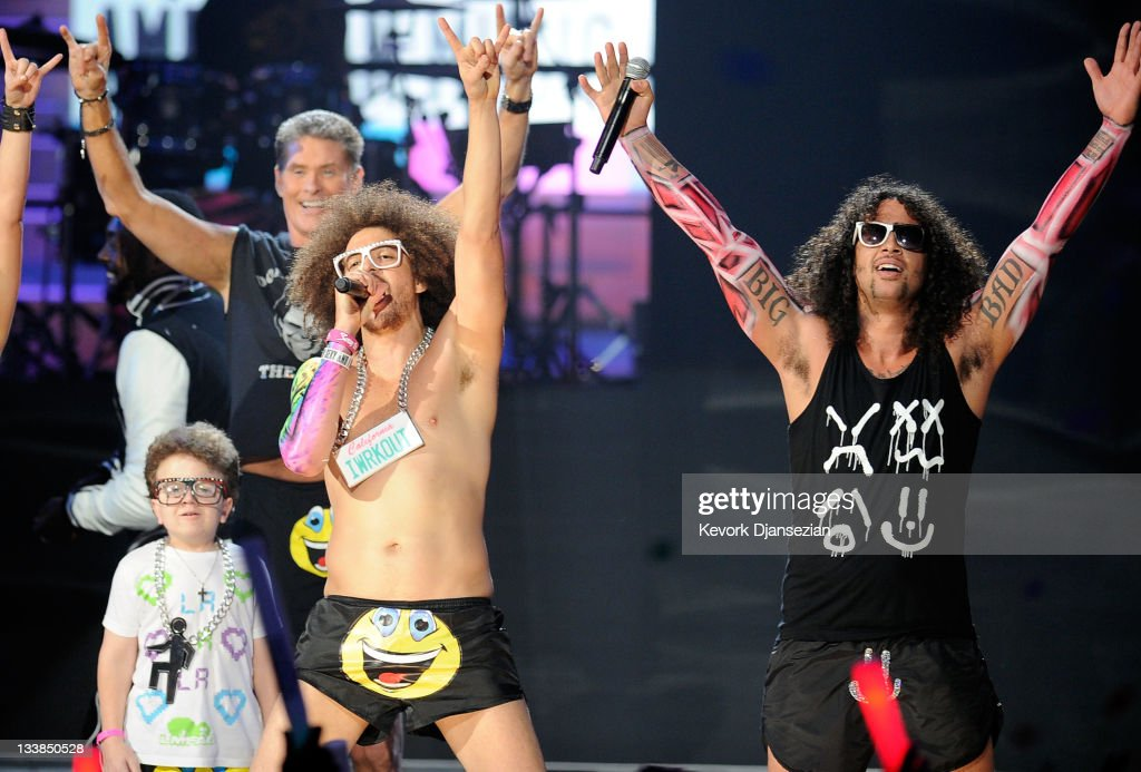 Keenan Cahill, Redfoo and SkyBlu of LMFAO perform onstage at the 2011 American Music Awards held at Nokia Theatre L.A. LIVE on November 20, 2011 in Los Angeles, California.
