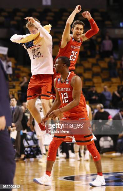 Keenan Evans and Davide Moretti of the Texas Tech Red Raiders celebrate defeating the Purdue Boilermakers 7865 in the 2018 NCAA Men's Basketball...