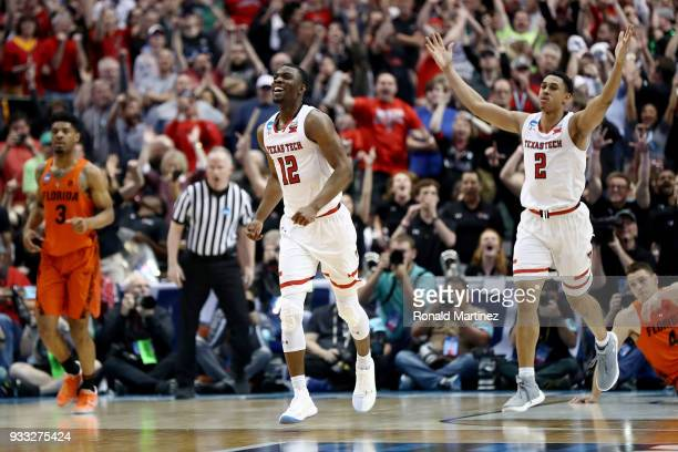 Keenan Evans and Zhaire Smith of the Texas Tech Red Raiders celebrate in the second half against the Florida Gators during the second round of the...