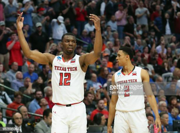 Keenan Evans of the Texas Tech Red Raiders celebrate alongside teammate Zhaire Smith in the second half against the Stephen F Austin Lumberjacks in...