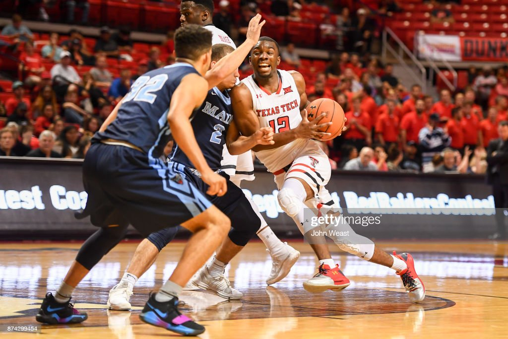 Keenan Evans #12 of the Texas Tech Red Raiders drives to the basket against Celio Araujo #2 of the Maine Black Bears during the game on November 14, 2017 at United Supermarkets Arena in Lubbock, Texas. Texas Tech defeated Maine 83-44.