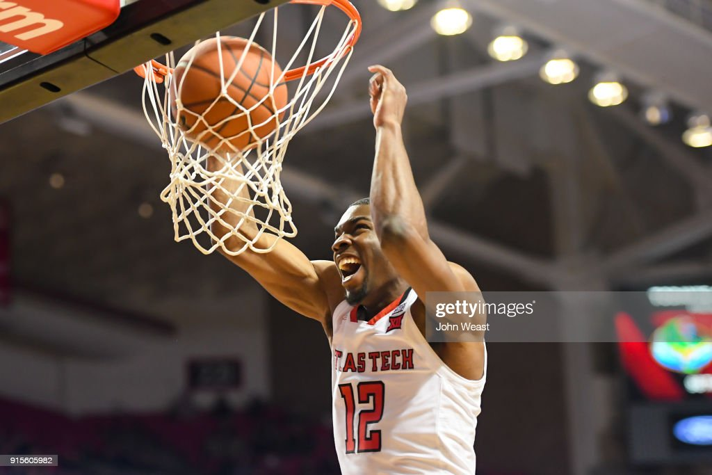 Keenan Evans #12 of the Texas Tech Red Raiders dunks the basketball during the second half of the game against the Iowa State Cyclones on February 7, 2018 at United Supermarket Arena in Lubbock, Texas. Texas Tech defeated Iowa State 76-58.