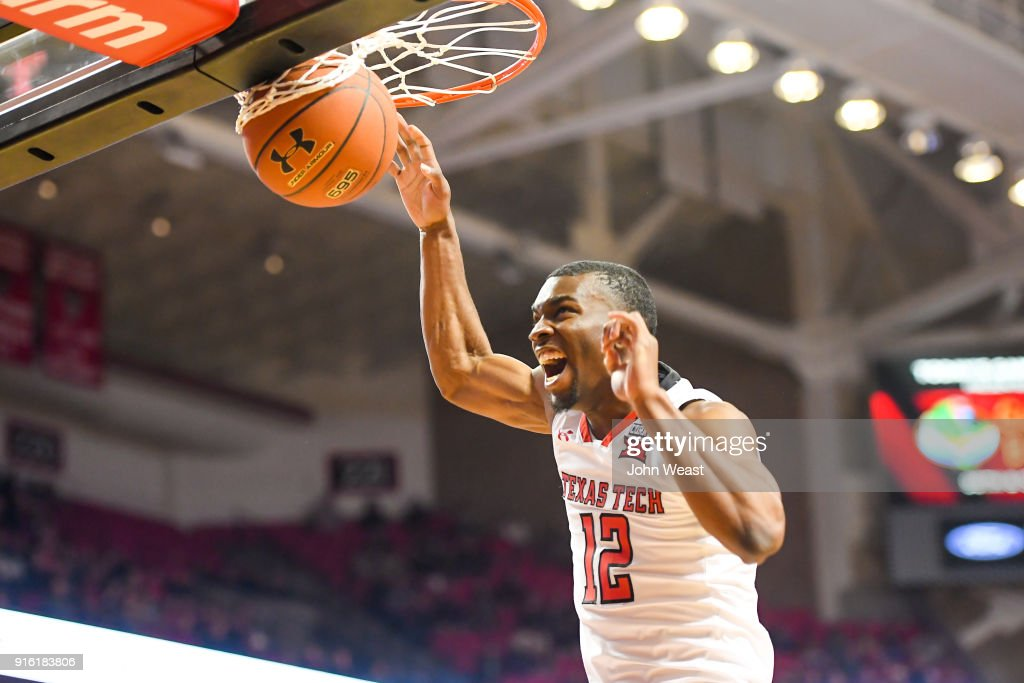 Keenan Evans #12 of the Texas Tech Red Raiders dunks the basketball during the game against the Iowa State Cyclones on February 7, 2018 at United Supermarket Arena in Lubbock, Texas. Texas Tech defeated Iowa State 76-58.