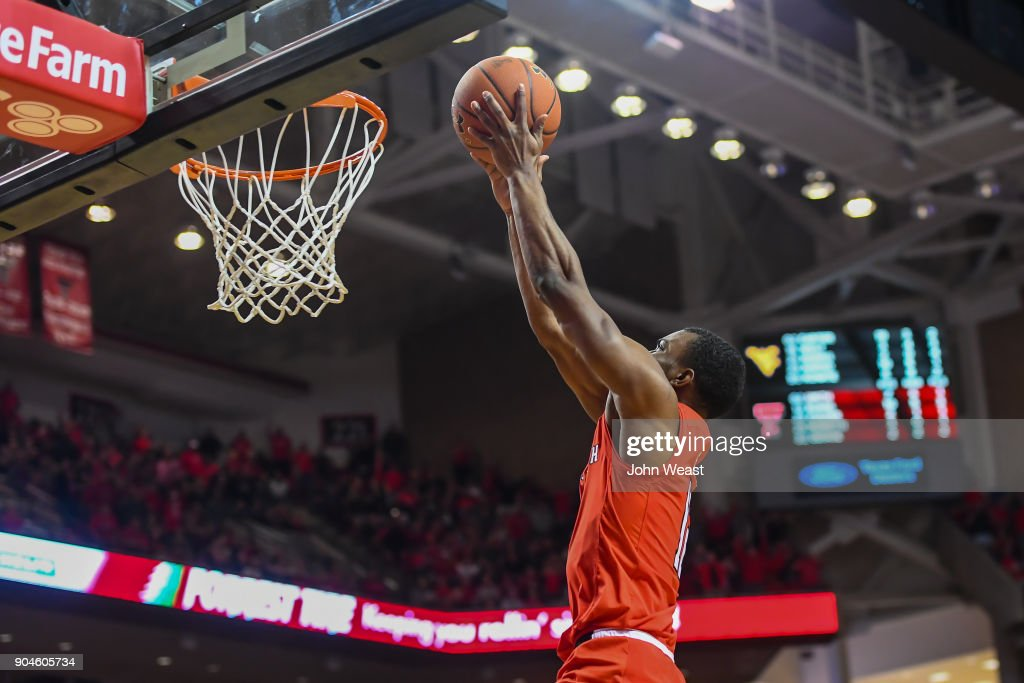 Keenan Evans #12 of the Texas Tech Red Raiders goes in for the dunk during the game against the West Virginia Mountaineers on January 13, 2018 at United Supermarket Arena in Lubbock, Texas.