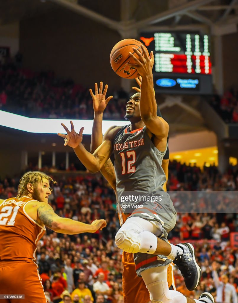 Keenan Evans #12 of the Texas Tech Red Raiders goes to the basket during the game against the Texas Longhorns on January 31, 2018 at United Supermarket Arena in Lubbock, Texas. Texas Tech defeated Texas 73-71 in overtime.