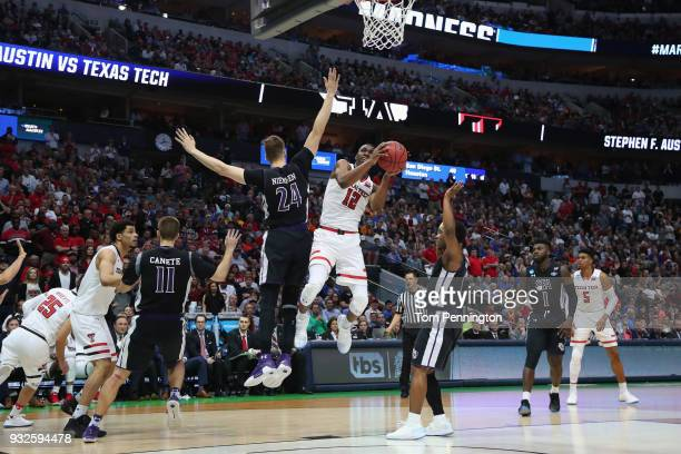 Keenan Evans of the Texas Tech Red Raiders goes up for a shot against Samuli Nieminen of the Stephen F Austin Lumberjacks in the second half in the...