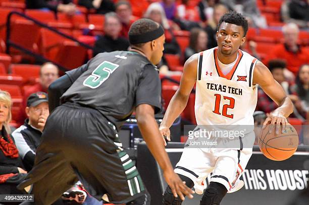 Keenan Evans of the Texas Tech Red Raiders handles the ball while guarded by Roderick Bobbitt of the Hawaii Warriors during the game on November 28...