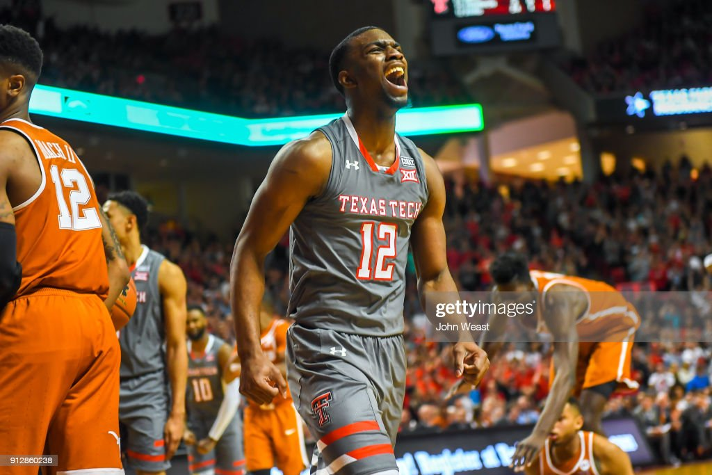 Keenan Evans #12 of the Texas Tech Red Raiders reacts to a basket during the game against the Texas Longhorns on January 31, 2018 at United Supermarket Arena in Lubbock, Texas. Texas Tech defeated Texas 73-71 in overtime.