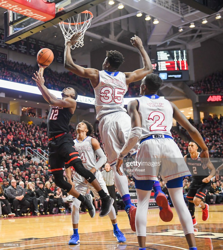 Keenan Evans #12 of the Texas Tech Red Raiders shoots the ball against the defense of Udoka Azubuike #35 of the Kansas Jayhawks during the first half of the game on February 24, 2018 at United Supermarket Arena in Lubbock, Texas.