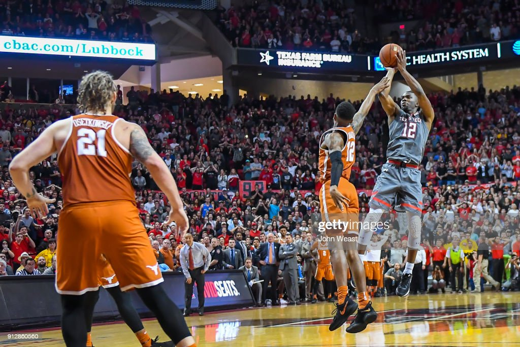 Keenan Evans #12 of the Texas Tech Red Raiders shoots the winning basket during the game against the Texas Longhorns on January 31, 2018 at United Supermarket Arena in Lubbock, Texas. Texas Tech defeated Texas 73-71 in overtime.