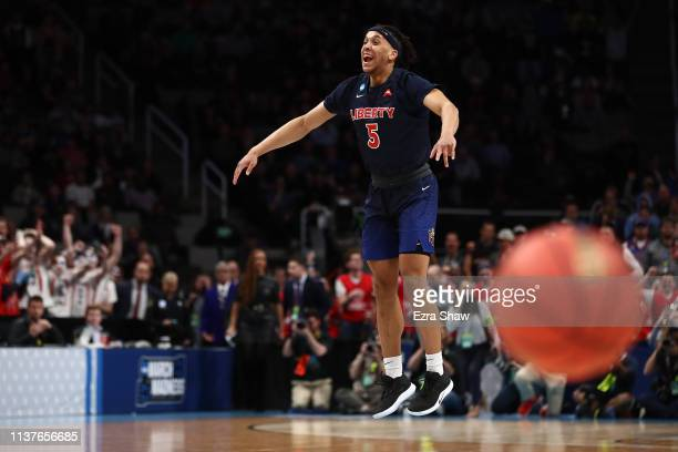Keenan Gumbs and the Liberty Flames celebrate their 8076 win over the Mississippi State Bulldogs during their game in the First Round of the NCAA...