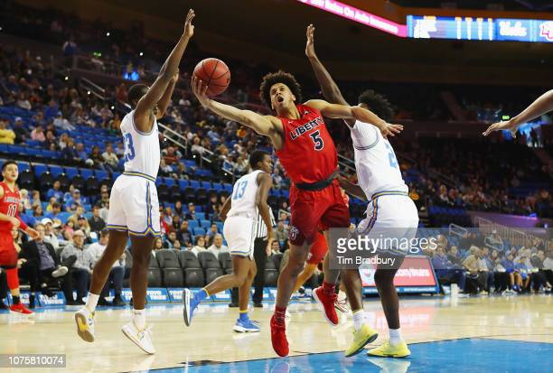 Keenan Gumbs of the Liberty Flames drives to the basket during the first half against the UCLA Bruins at Pauley Pavilion on December 29 2018 in Los...