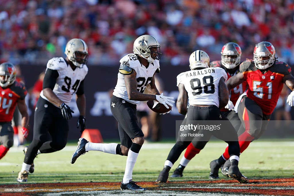 Keenan Lewis #28 of the New Orleans Saints returns an interception in the second half of the game against the Tampa Bay Buccaneers at Raymond James Stadium on December 28, 2014 in Tampa, Florida. The Saints defeated the Bucs 23-20.