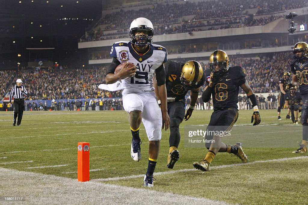 Keenan Reynolds #19 of the Navy Midshipmen scores the game-winning touchdown during a game against the Army Black Knights on December 8, 2012 at Lincoln Financial Field in Philadelphia, Pennsylvania. The Navy won 17-13.