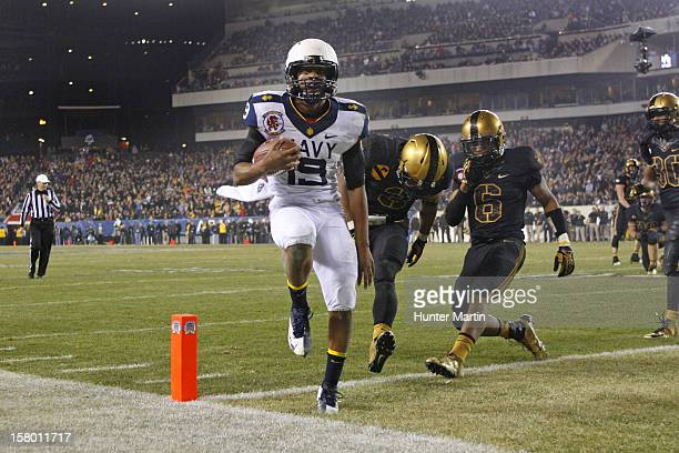 Keenan Reynolds of the Navy Midshipmen scores the gamewinning touchdown during a game against the Army Black Knights on December 8 2012 at Lincoln...
