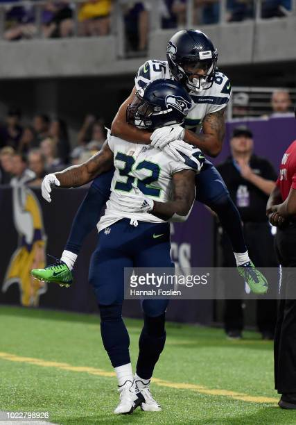 Keenan Reynolds of the Seattle Seahawks congratulates teammate Chris Carson on scoring a touchdown against the Minnesota Vikings during the second...