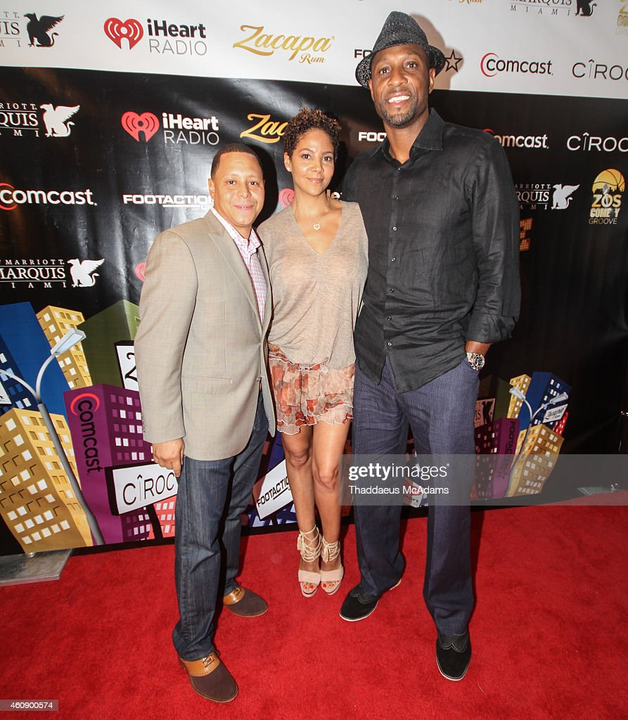 Keenan Towns, Tracy Mourning and Alonzo Mourning at JW Marriott Marquis on December 28, 2014 in Miami, Florida.
