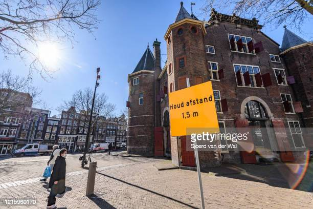 Keep 1.5 m distance sign on the street in Amsterdam during a weekday morning following the advice of the Dutch government to stay at home for...