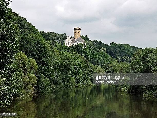CONTENT] Keep and buildings of the castle surrounded by forest Situated in Hesse near Limburg and the River Lahn
