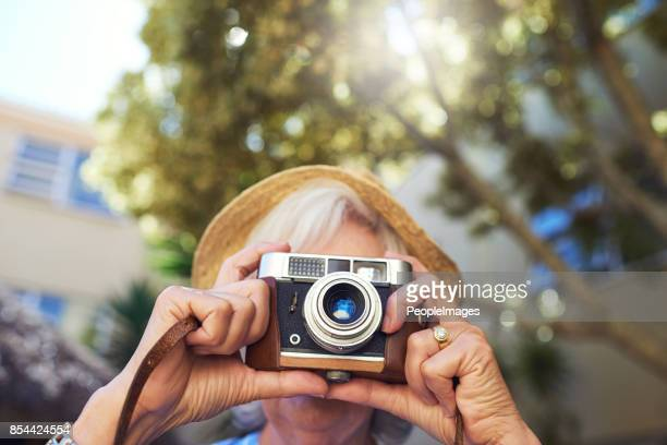 keep capturing the moments - photographic film camera stock photos and pictures